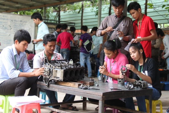 Young Cambodians attending mechanical training in Phnom Penh
