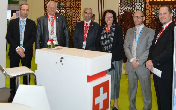 SFOE director, Dr. Steinmann, (second from left) and Swiss Ambassador, Maya Tissafi (third from right) visit the Swiss Pavilion
