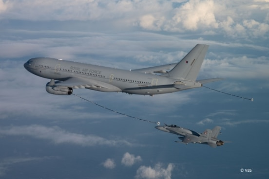 A tanker aircraft refueling a jet in mid-air