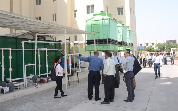 Engineer explaining how a water-cooled air conditioning system works.