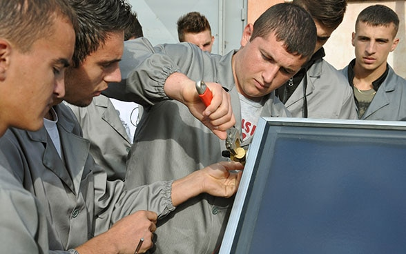 Apprentices in Albania working on a thermo-hydraulic machine