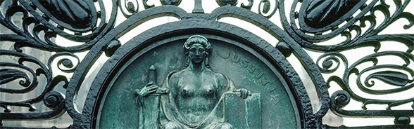 Image of the statue of Justice on the gate of the Peace Palace in The Hague