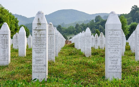 A cemetery with identical, white gravestones at the Srebrenica Genocide Memorial in what is now Bosnia and Herzegovina.
