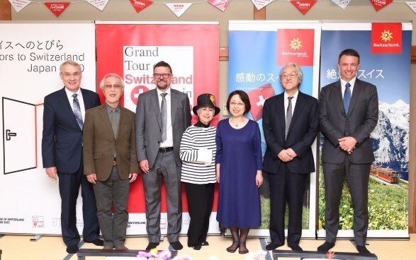"From left: Mr. Jean-François Paroz, the Ambassador of Switzerland to Japan, Mr. Yoichi Kotabe, animator and character designer / ""A father of Heidi"", Mr. Martin Michel, Director of Ballenberg open-air museum, Ms. Kazuko Sugiyama, Heidi voice actress, Ms. Terue Nakamaru, president of KIKYOUYA Co., Ltd, Mr. Shinji Nakamaru, Representative director of Heidi's Village, Mr. Fabien Clerc, Director Switzerland Tourism Japan"
