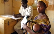 Woman during a medical consultation with her baby in Gambia