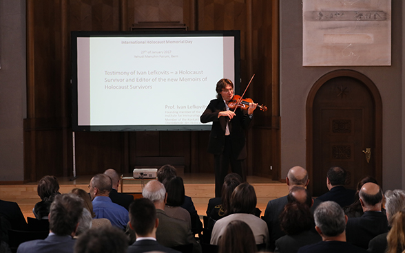 Musical interlude by violinist Piotr Plawner during the ceremony marking International Holocaust Remembrance Day.