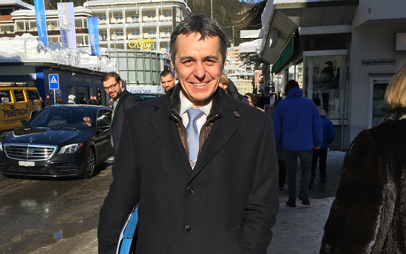 Federal councillor Ignazio Cassis on the streets of Davos during the World Economic Forum.